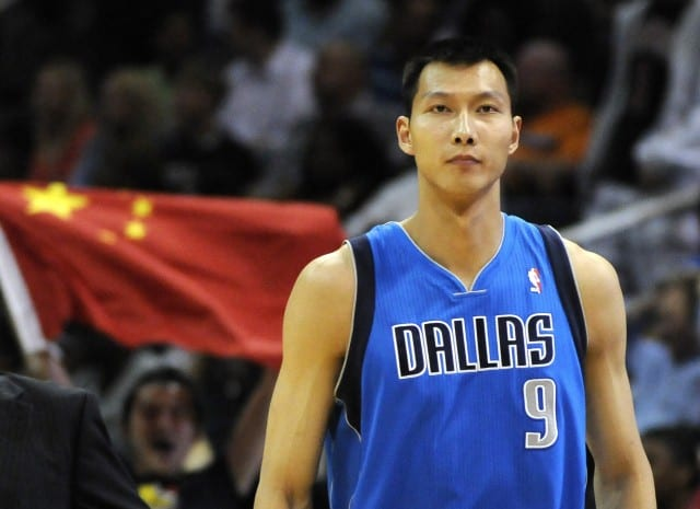 Dallas Mavericks forward Yi Jianlian of China enters the game in the second half of their NBA basketball game against the Atlanta Hawks in Atlanta