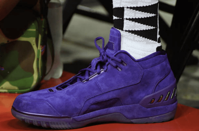 69800b9fa479 LeBron James Watches Lakers Summer League Game In Unreleased Purple Suede  Nike Zoom Generation
