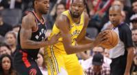 Golden State Warriors forward Kevin Durant is defended by Toronto Raptors forward Kawhi Leonard