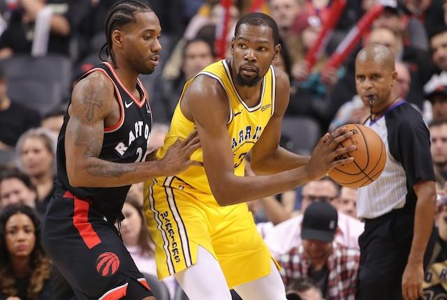 Golden State Warriors forward Kevin Durant is defended by Toronto Raptors forward Kawhi Leonard