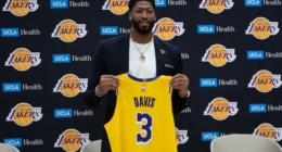 Los Angeles Lakers forward Anthony Davis holds his new No. 3 jersey during an introductory press conference