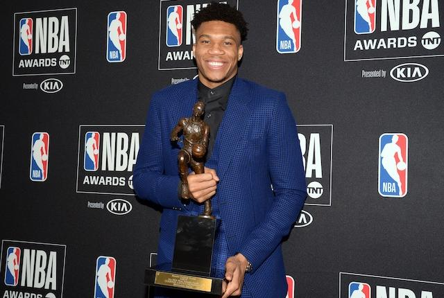 Milwaukee Bucks forward Giannis Antetokounmpo with his 2019 MVP Award at the NBA Awards Show