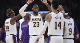 Los Angeles Lakers teammates Danny Green, Dwight Howard, LeBron James and Rajon Rondo celebrate