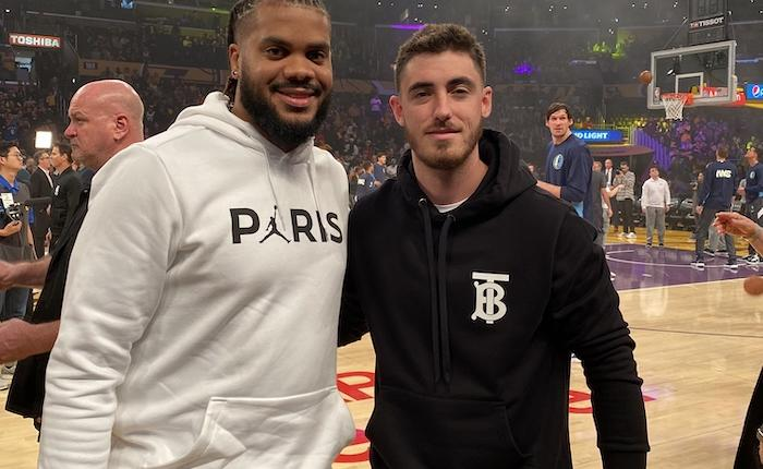 Los Angeles Dodgers teammates Cody Bellinger and Kenley Jansen watch a Los Angeles Lakers game at Staples Center
